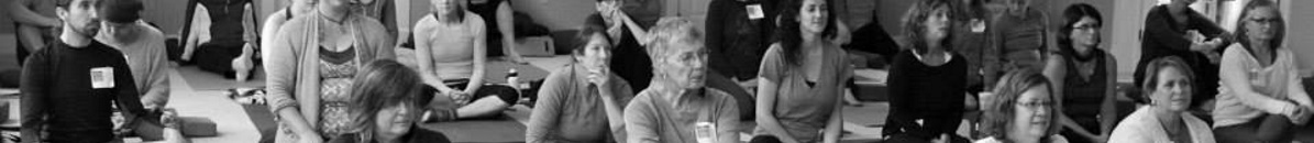 Yoga conference attendees listening to a talk