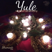 candles and garland on altar for Yule Ceremony